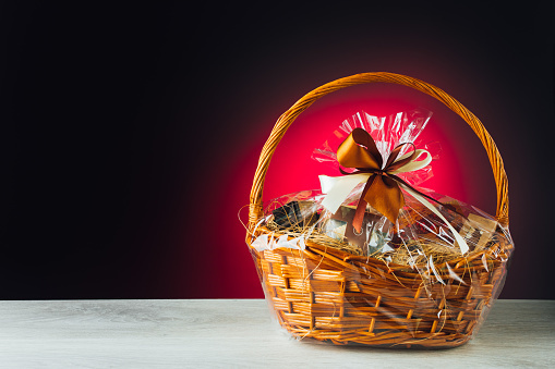 gift basket on purple background, close-up view